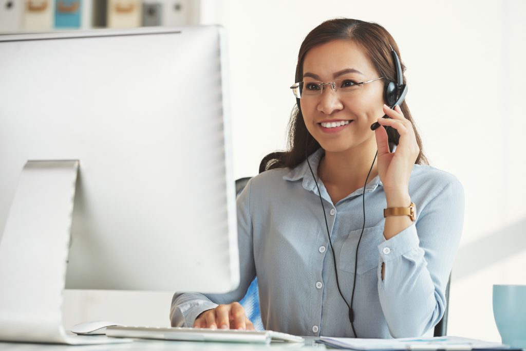 Smiling business lady working in call center