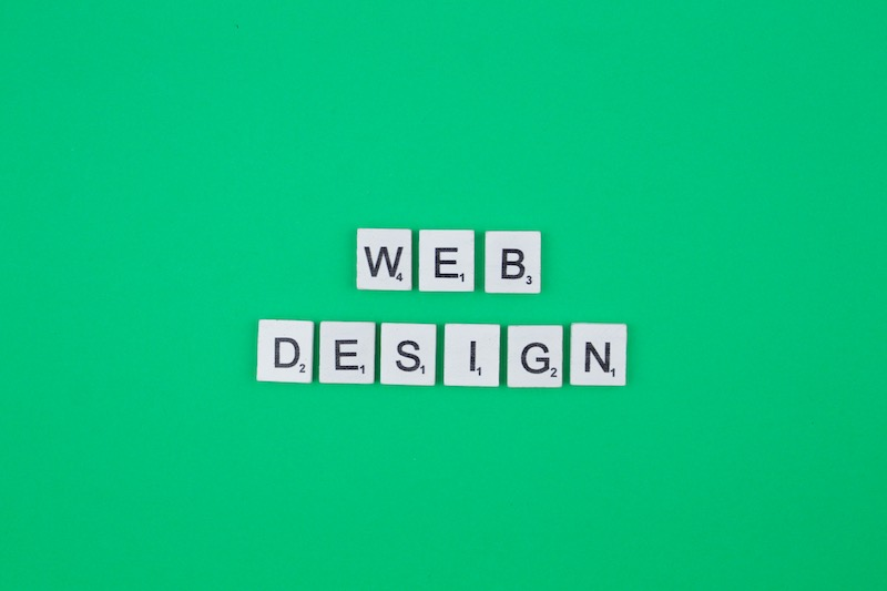 web design scrabble letters word on a green background